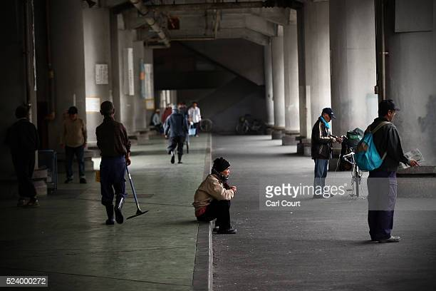 Homeless men wait around for the offer of work in the slum area of Kamagasaki on April 23 2016 in Osaka Japan Kamagasaki a district in Japan's second...