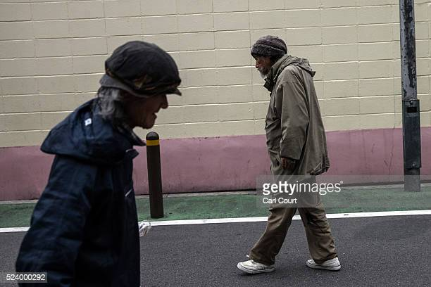 Homeless men walk along a street in the slum area of Kamagasaki on April 23 2016 in Osaka Japan Kamagasaki a district in Japan's second largest city...