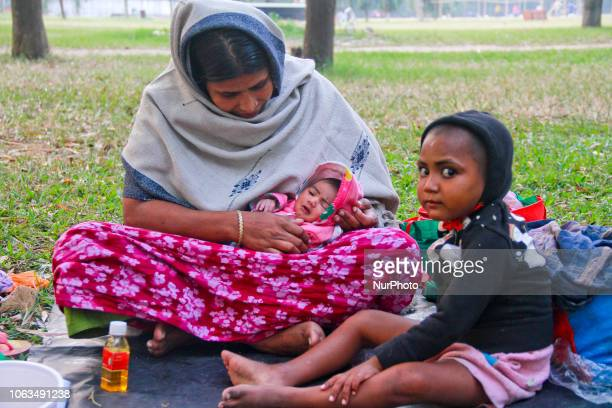 A homeless mother is getting prepared to spent a long cold night under the open sky in a park with her 2 daughters one is 10 days old and the other...