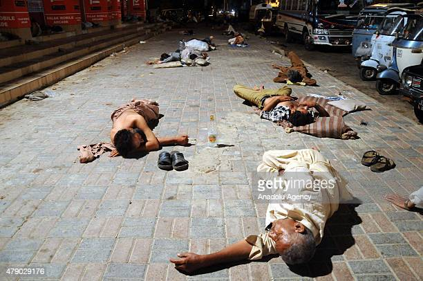 Homeless Pakistani people rest on the pavement during a heatwave in Karachi Pakistan on June 30 2015 A Pakistani official says the devastating...