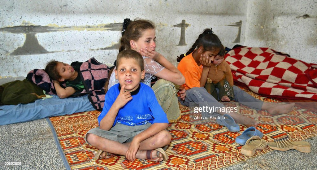 Homeless Palestinian children rest indoors whilst staying temporarily at a United Nations school after their house was recently demolished during an Israeli army raid May 20, 2004 in Rafah, Gaza. Israeli troops and tanks pushed further into the besieged Rafah refugee camp on Thursday despite international outrage at the killing of 40 Palestinians in the bloodiest Gaza raid in years.