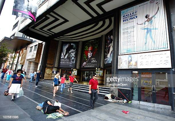 Homeless people are seen sleeping and begging on the pedestrian path at the famous boulevard Gran Via in Madrid on May 24 2010 in Madrid Spain Madrid...