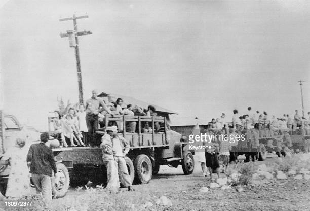 Homeless people are taken to emergency accommodation on US Army trucks 9th April 1946 after a Pacificwide tsunami hit Hilo Hawaii The tidal wave on...
