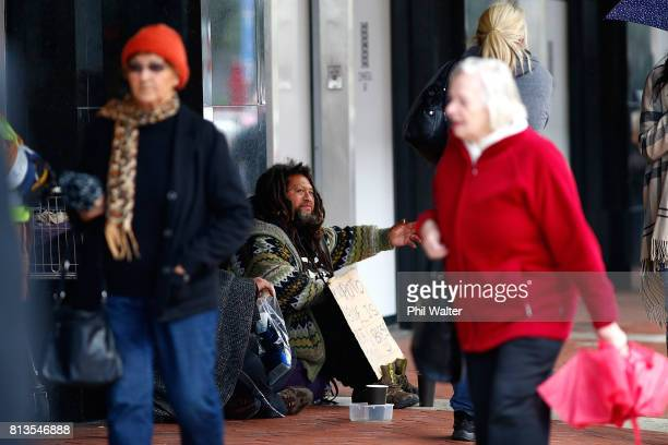 Homeless people beg for money in the Auckland CBD on July 13 2017 in Auckland New Zealand Research by Roy Morgan found that economic issues were of...