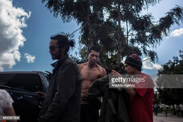 Homeless people get clothes distributed by volunteers in Bogota Colombia on December 15 2017 Homeless people who are called 'CHC' Ciudadanos...