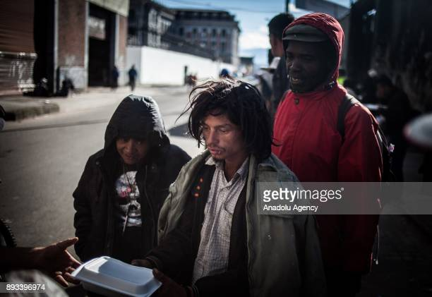 Homeless people get food distributed by volunteers in Bogota Colombia on December 15 2017 Homeless people who are called 'CHC' Ciudadanos Habitantes...
