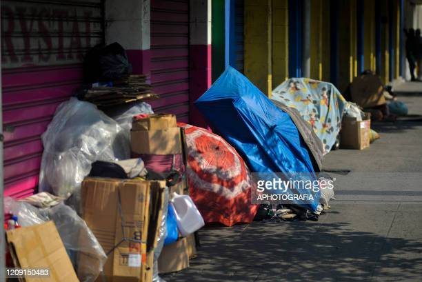Homeless people set their belongings on the street where they will live through the COVID19 crisis on April 2 2020 in San Salvador El Salvador On...
