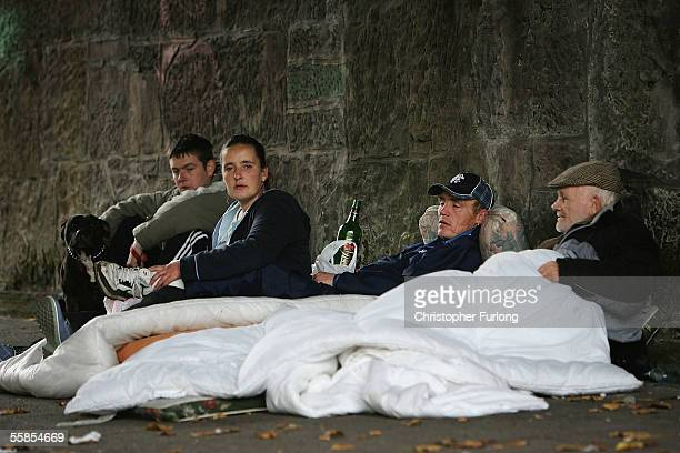 Homeless people sit under a bridge where they live on the banks of the River Clyde on Ocotober 5 2005 in Glasgow Scotland UK Homeless charity Shelter...