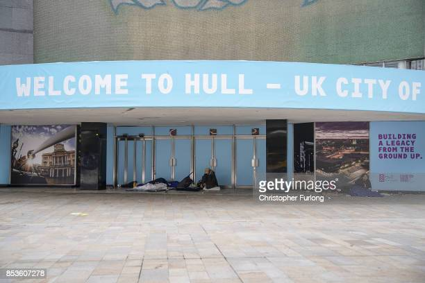 Homeless people sleep beneath a 'Hull UK City of Culture 2017' advertising hoarding that adorns an empty building on September 25 2017 in Hull England