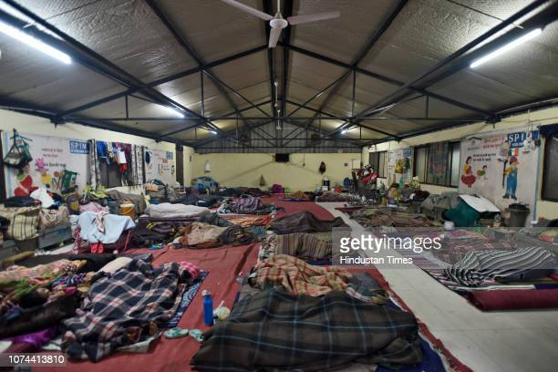 Homeless people sleep inside a shelter home at Sarai Kale Khan on December 18 2018 in New Delhi India There are some 83 permanent shelters and 115...