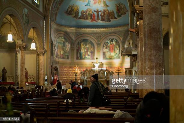 Homeless people sleep inside St Boniface Church in the Tenderloin district of San Francisco California US on Monday Jan 19 2015 In a city where...
