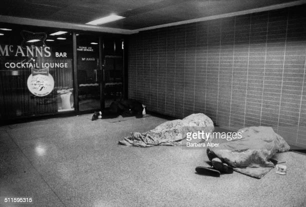Homeless people sleeping outside McAnn's Bar in Pennsylvania Station, New York City, 1990.