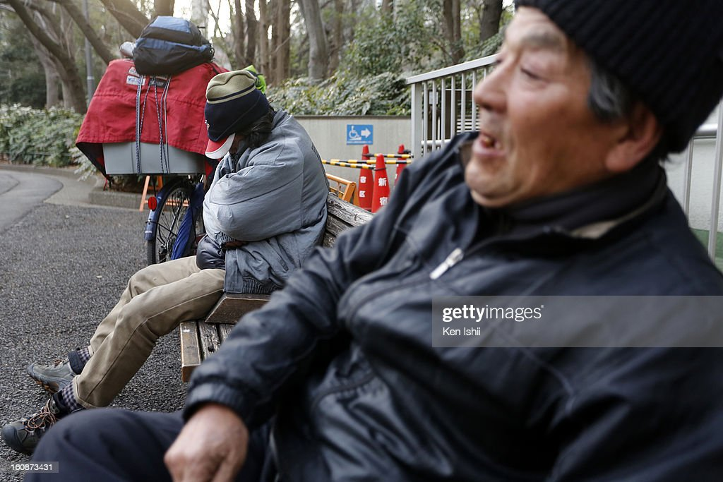 Homeless people spend time at Shunjuku Central Park on February 7, 2013 in Tokyo, Japan. A recent servey shows Tokyo as the most expensive city in the world and Osaka ranked second.