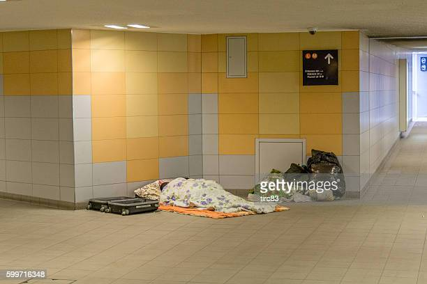 Homeless person asleep in Budapest Metro subway