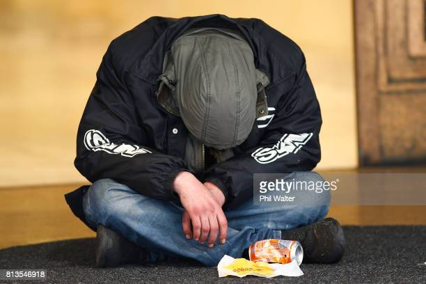 A homeless person begs for money in the Auckland CBD on July 13 2017 in Auckland New Zealand Research by Roy Morgan found that economic issues were...