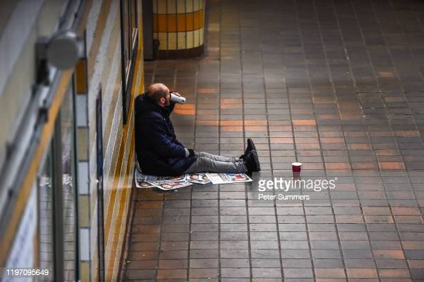 A homeless person drinks from a can of beer in an Underground station on January 28 2020 in London England The UK Government has pledged an...