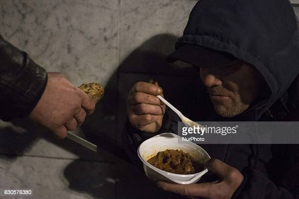 Homeless person during Christmas Eve dinner for homeless persons made by quotDaj Herbatequot foundation near Central Railway Station in Warsaw Poland...