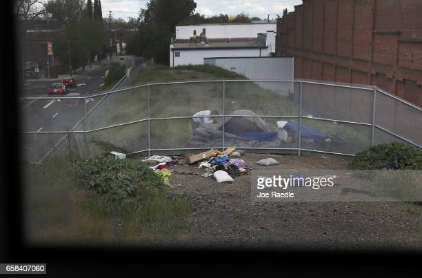 A homeless person is seen as Amtrak's California Zephyr passes through during its daily 2438mile trip to Emeryville/San Francisco from Chicago that...