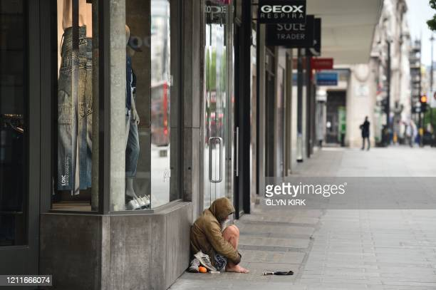 Homeless person is seen on Oxford Street in central London on May 3 during the nationwide lockdown due to the novel coronavirus COVID-19 pandemic. -...