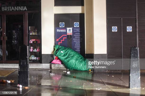 Homeless person is seen sleeping in a doorway on December 13, 2020 in London, England. The number of new rough sleepers has risen in London this year...