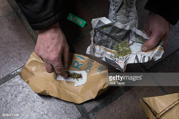 A homeless person rolls up Spice a synthetic cannabis substitute into a cigarette while in an underpass by Charing Cross Station on December 8 2016...