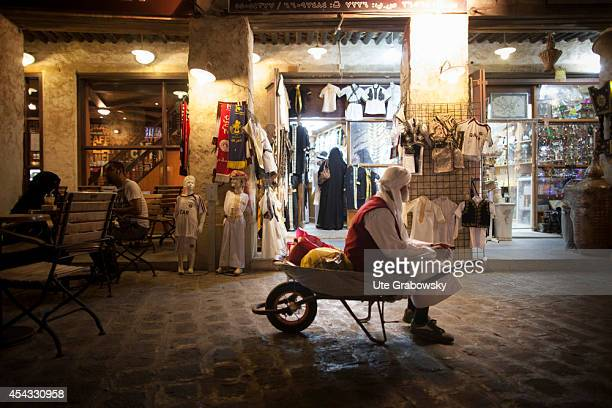 Homeless person sitting in a wheelbarrow on the Souq Waqif on May 31 in Doha Qatar This market dates back at least a hundred years and it was...