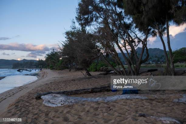 homeless person sleeping on the beach - brycia james stock pictures, royalty-free photos & images