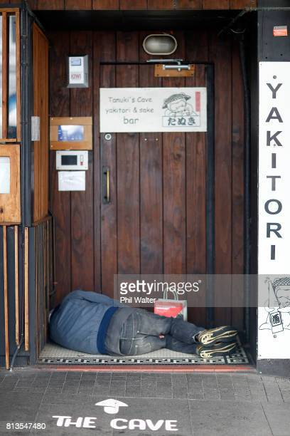 A homeless person sleeps in a doorway in the Auckland CBD on July 13 2017 in Auckland New Zealand Research by Roy Morgan found that economic issues...