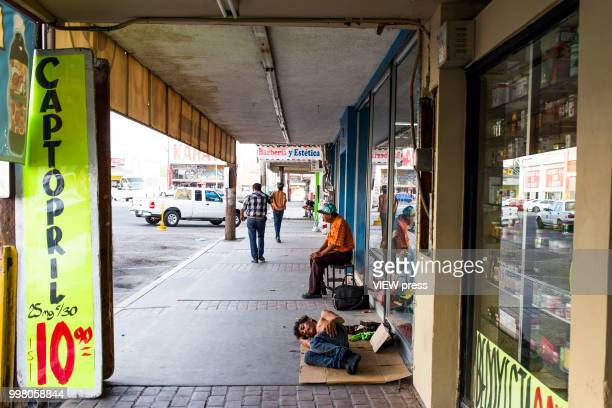 MEXICALI MEXICO July 10 A homeless person sleeps on the street near Hotel del Migrante on July 10 2018 in Mexicali Mexico Hotel del Migrante is a...