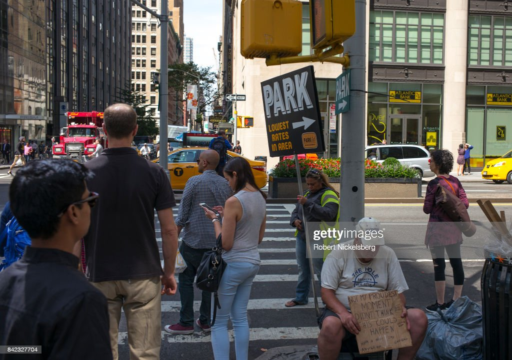 Pedestrians And Homeless In New York City : News Photo