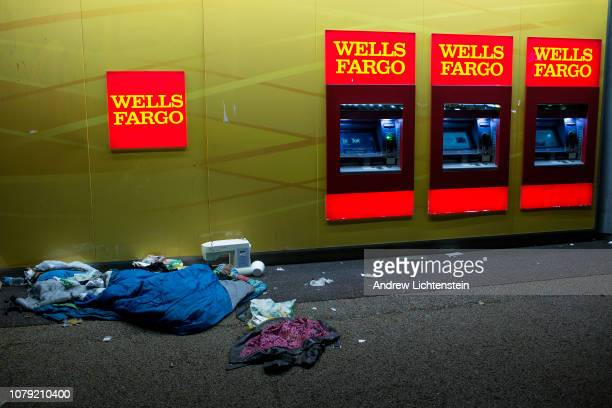 A homeless person's belongings lie scattered on the street next to a bank on December 6 2018 in Los Angeles California