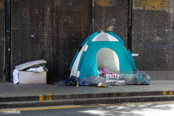 Homeless person's tent seen under a bridge in London.