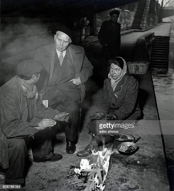 Homeless persons under the bridge in Paris Ca 1950