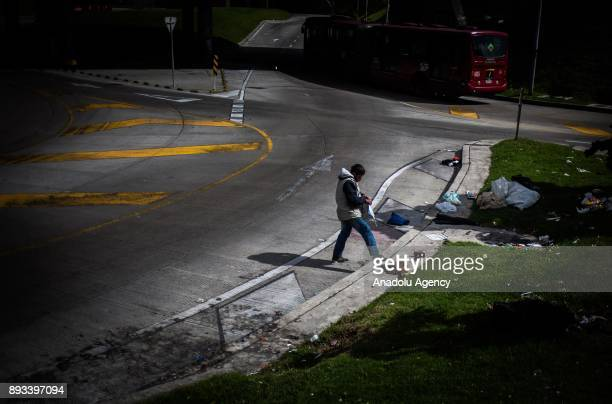 A homeless prepares his lunch at a park distributed by volunteers in Bogota Colombia on December 15 2017 Homeless people who are called 'CHC'...