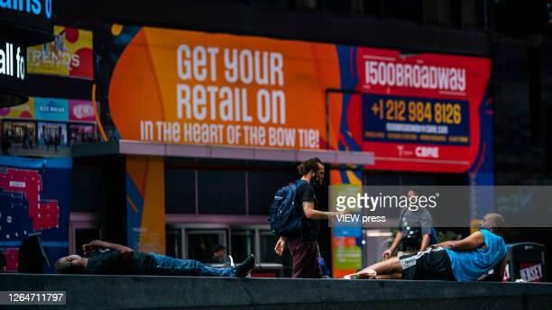 Homeless rest in Times Square on August 8 2020 in New York City With more than four months NYC has closed some of their doors to combat the...