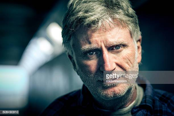 homeless senior adult man with beard in subway tunnel - stubble stock pictures, royalty-free photos & images