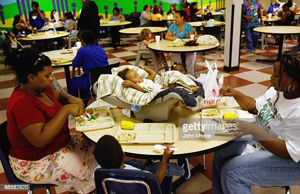Homeless six-month-old baby Maleya Nevills sleeps while her family eats dinner at the Family Gateway homeless shelter on June 18, 2009 in Dallas,...