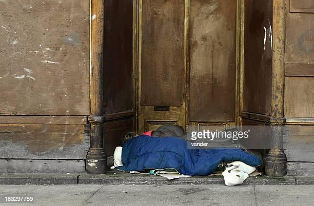 Homeless sleeping on ground.