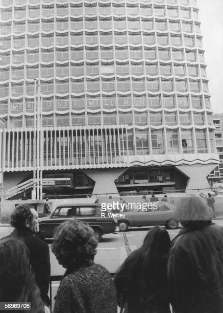 Homeless squatters take up residence in Centre Point an empty office block in central London 19th January 1974 They decorate the windows with the...