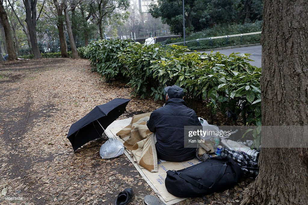 A homeless, staying at Shunjuku Central Park on February 7, 2013 in Tokyo, Japan. A recent servey shows Tokyo as the most expensive city in the world and Osaka ranked second.
