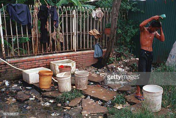 A homeless teenage drug addict takes his first bath of the day in the early afternoon at a hidden squat in the middle of Phnom Penh Several other...
