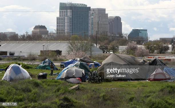 Homeless tent city sits in front of the Sacramento skyline March 4, 2009 in Sacramento, California. The tent city is seeing an increase in population...