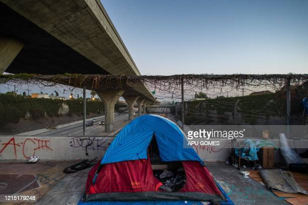 A homeless tent is seen over a bridge on the 110 Freeway during the novel Coronavirus COVID19 pandemic in Los Angeles California on May 25 2020 On...