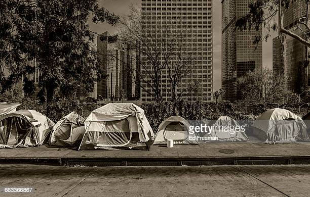 homeless tents, skyscrapers in background - homelessness stock pictures, royalty-free photos & images