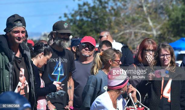 Homeless transients wait to be taken away on buses from the Shomeless encampment beside the Santa Ana River on February 20 2018 in Anaheim California...