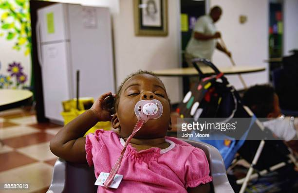 Homeless two-year-old Krystal Davis sleeps while her mother cleans up at the Family Gateway homeless shelter on June 18, 2009 in Dallas, Texas. The...
