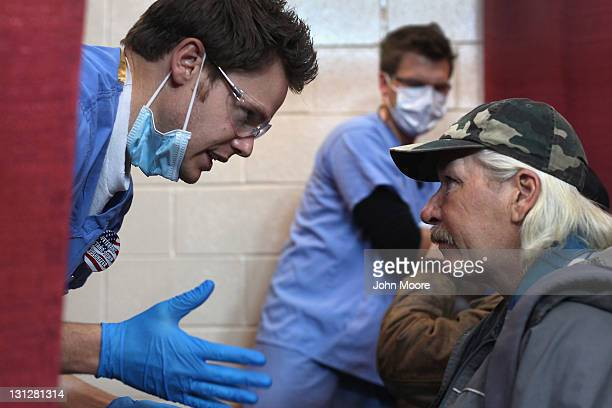Homeless US Army veteran and unemployed carpenter Steven Wise receives a dental checkup at a Stand Down event hosted by the Department of Veterans...
