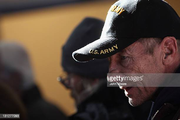 A homeless US military veteran stands in line for free winter clothing at a Stand Down event hosted by the Department of Veterans Affairs on November...
