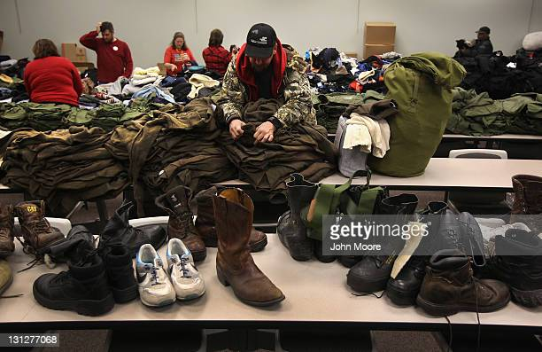 Homeless US Navy veteran Wayne Hamilton looks for his size while collecting free clothing at a Stand Down event hosted by the Department of Veterans...