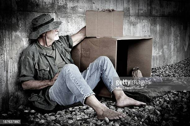 homeless veteran holds blank cardboard sign - homeless veterans stock photos and pictures